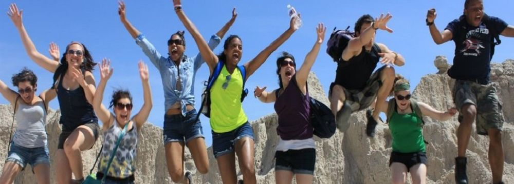 Students jumping while visiting the Badlands in South Dakota