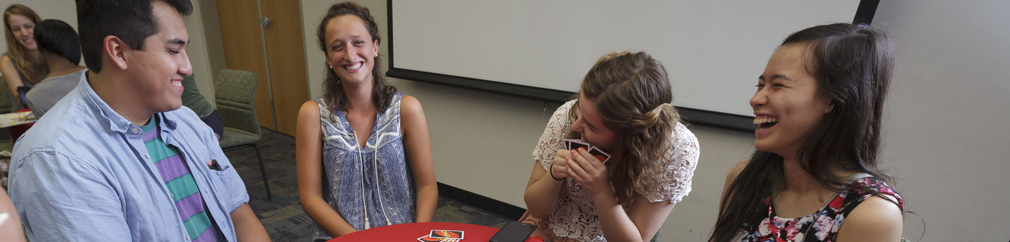Students playing the card game UNO at iPlay during Welcome Week